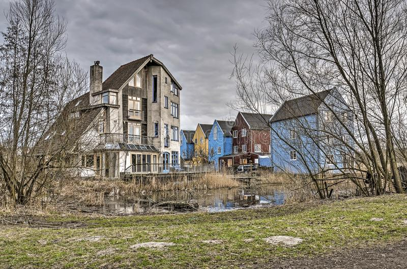 Experimental housing in the Netherlands. Culemborg, The Netherlands, March 4, 2018: informal and green public space around houses and buildings in experimental royalty free stock photos