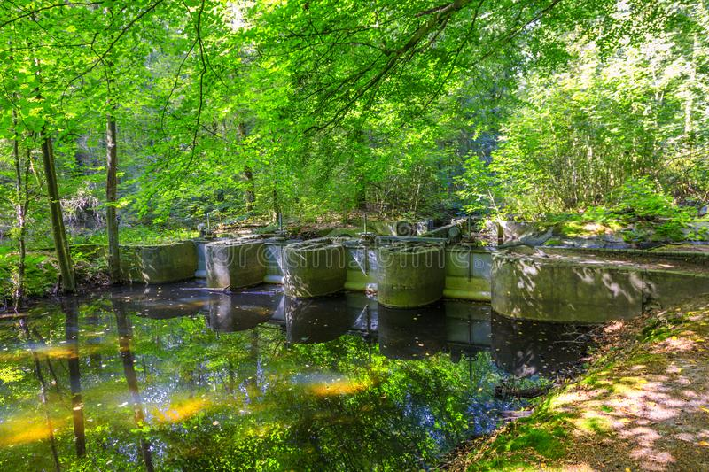 Experimental installations in the Waterloopbos. Watercourses with remnants of hydraulic experimental installations in the Waterloopbos in the Dutch province of royalty free stock photography