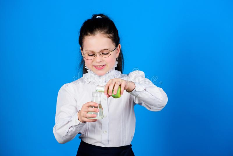 Experimenting a bit. Knowledge and information. Small kid study. Education concept. Basic knowledge. Knowledge day. Serious about studying. Schoolgirl with royalty free stock photo