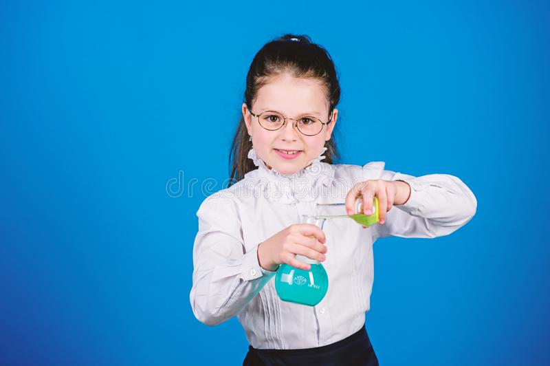 Experimenting a bit. Small kid study. Education concept. Basic knowledge. Knowledge day. Serious about studying. Schoolgirl with chemical liquids. Childhood stock photo