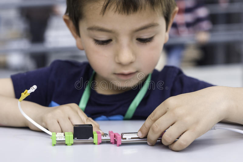 Experimenting with circuits. A child experimenting with electronics dimmers stock photo