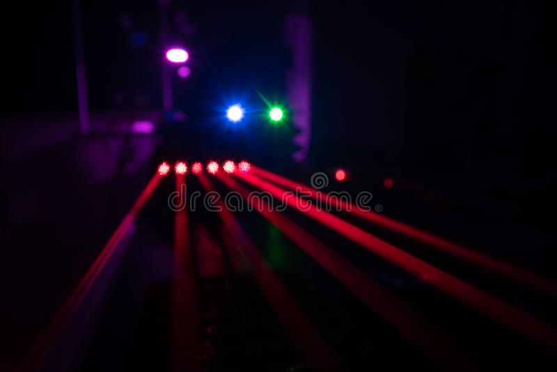 Experiments with lasers in the optics lab. Red laser on optical table in physics laboratory. Beam, research, experiment, science, laser, physics, lab, laboratory royalty free stock image