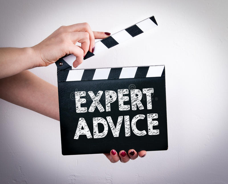 Expert Advice. Female hands holding movie clapper royalty free stock images