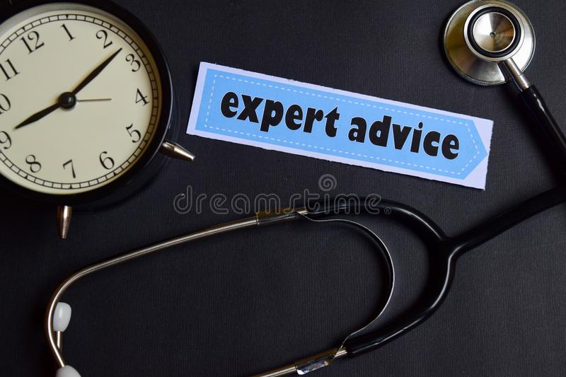 Expert Advice on the paper with Healthcare Concept Inspiration. alarm clock, Black stethoscope. royalty free stock photography
