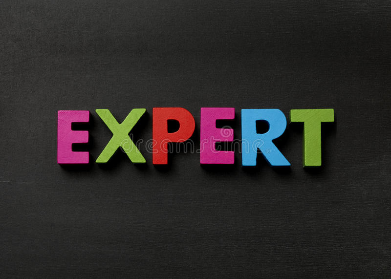 Expert. Blackboard with Expert in multi coloured text royalty free stock photo