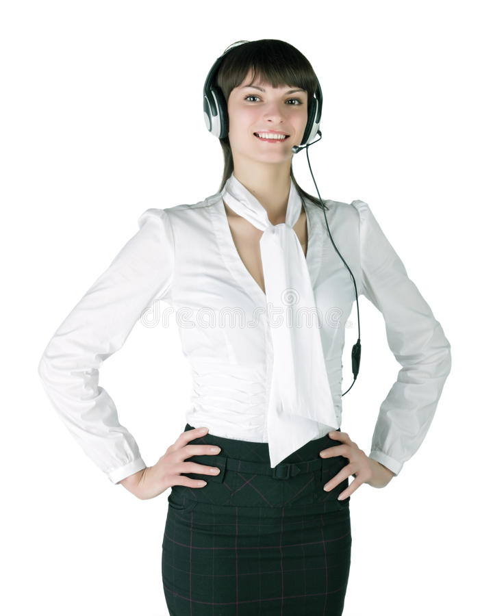 The expert call the centre. The fine girl in ear-phones with a microphone isolated on white background royalty free stock images