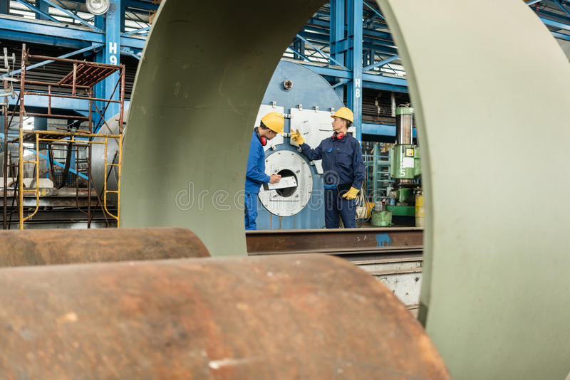 Expert checking the quality of manufactured boilers stock image