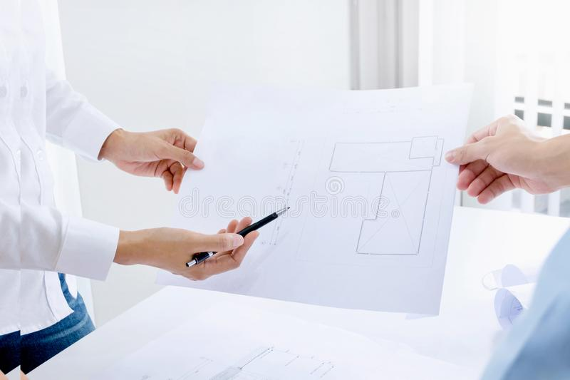 Expert engineers / business people discussing a building construction project at workplace stock photos