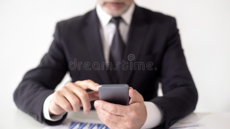 Expert reading news feed about foreign exchange market, insider information. Stock footage royalty free stock images