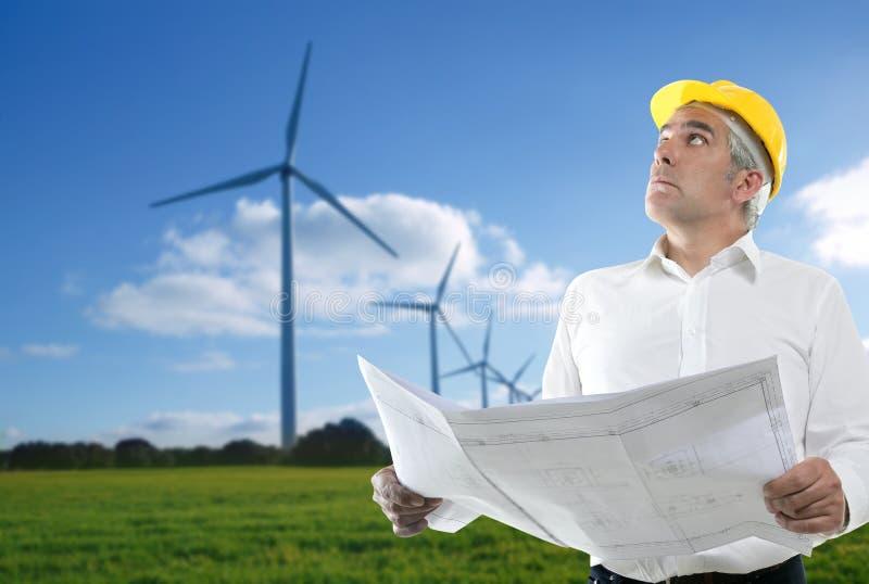 Expertise architect senior engineer plan windmill royalty free stock images