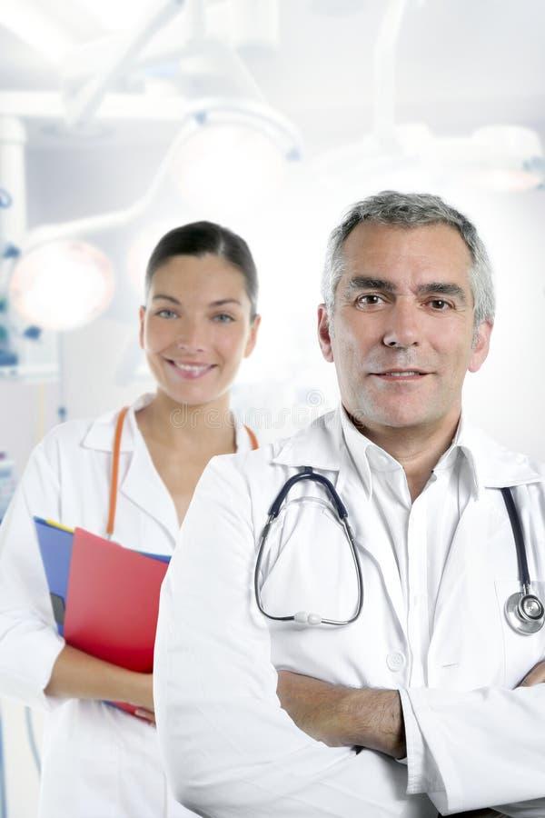 Expertise gray hair doctor beautiful nurse stock image