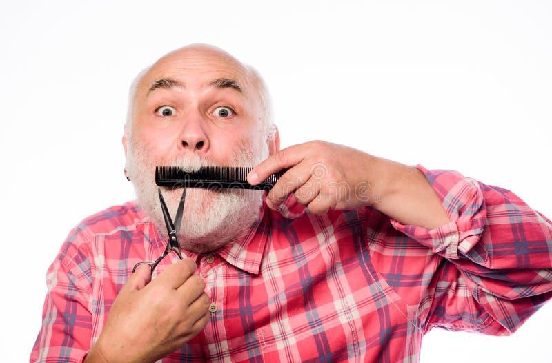 expertise Zak?adu fryzjerskiego poj?cie ogoli? wyposa?enia rżnięty i szczotkarski włosy dojrzały brodaty mężczyzna odizolowywając fotografia stock