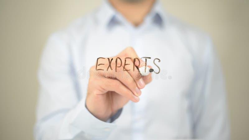 Experts, Man writing on transparent screen stock photos