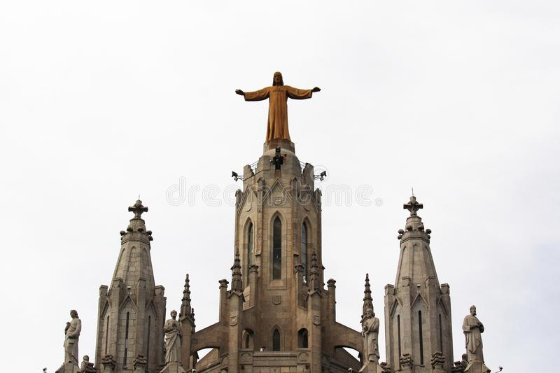 Expiatory Church of the Sacred Heart of Jesus, Tibidabo mountain, Barcelona. Jesus statue on the top of Expiatory Church of the Sacred Heart of Jesus at Tibidabo stock photography