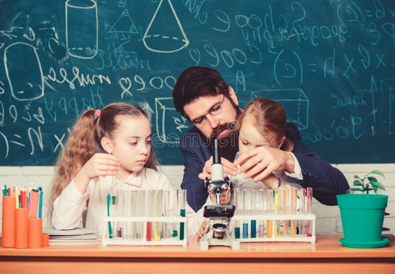 Explaining biology to children. How to interest children study. Fascinating biology lesson. Man bearded teacher work royalty free stock images