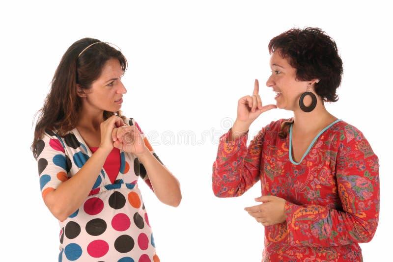 Expliquer de main de personnes sourdes photo stock