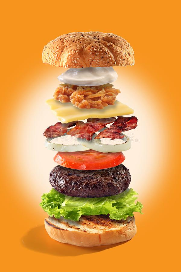 Exploded view burger. Exploded view of burger on orange background stock images