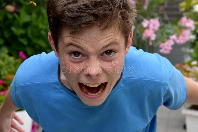 Exploding with anger. Teenager boy exploding with anger royalty free stock photography
