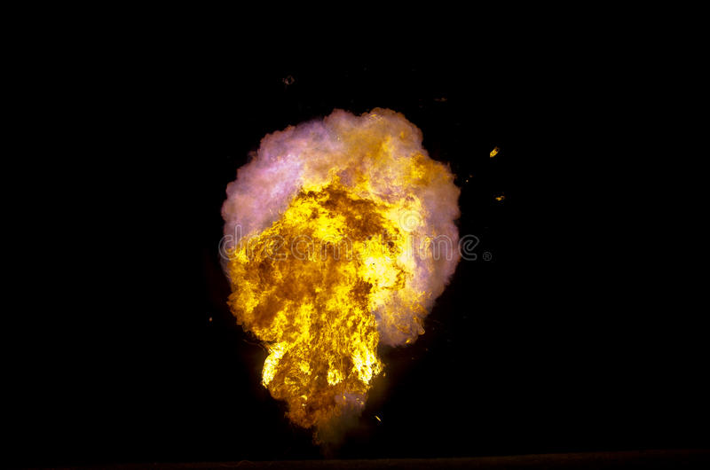 Exploding fireball. On a black background royalty free stock images