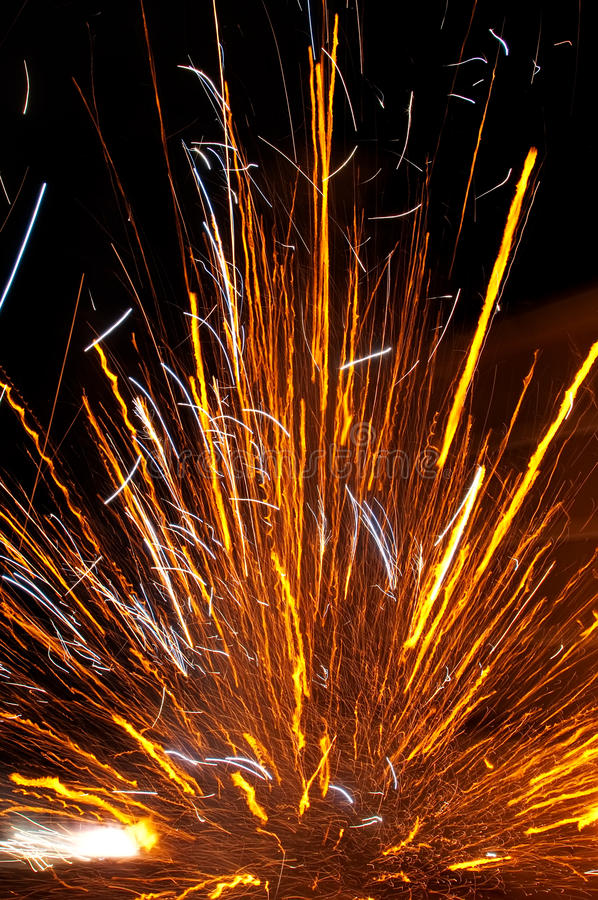 Exploding firecracker. Colorful firecracker exploding at night outdoors royalty free stock photos