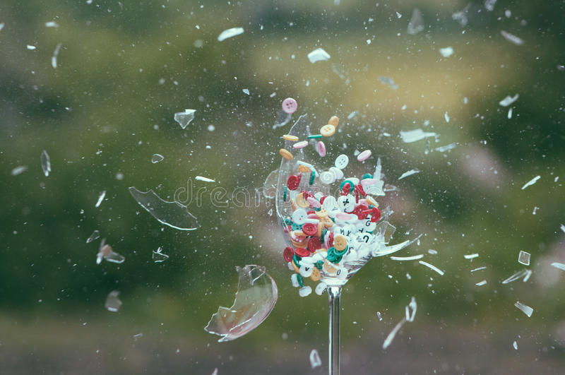 Exploding glass with Colored Buttons royalty free stock images