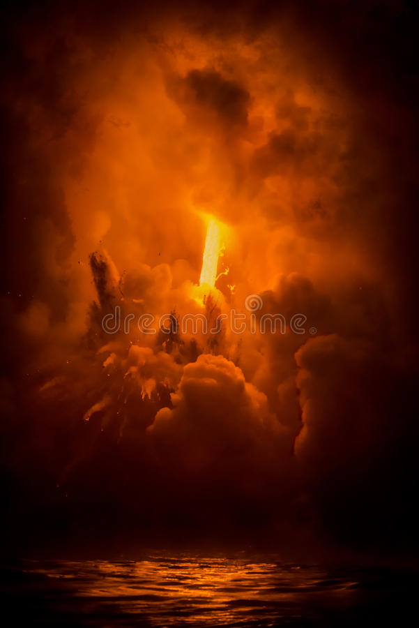 Exploding lava flow in Hawaii stock images