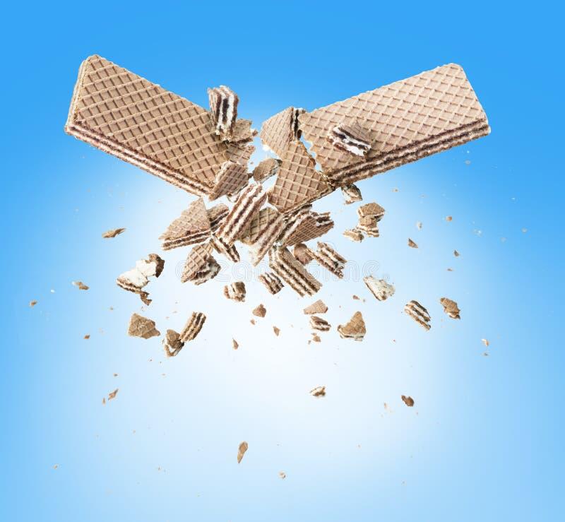 Exploding waffles. On blue background royalty free stock photo