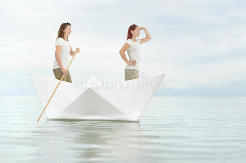 Exploration. Two girlfriends on a origami exploration royalty free stock photos