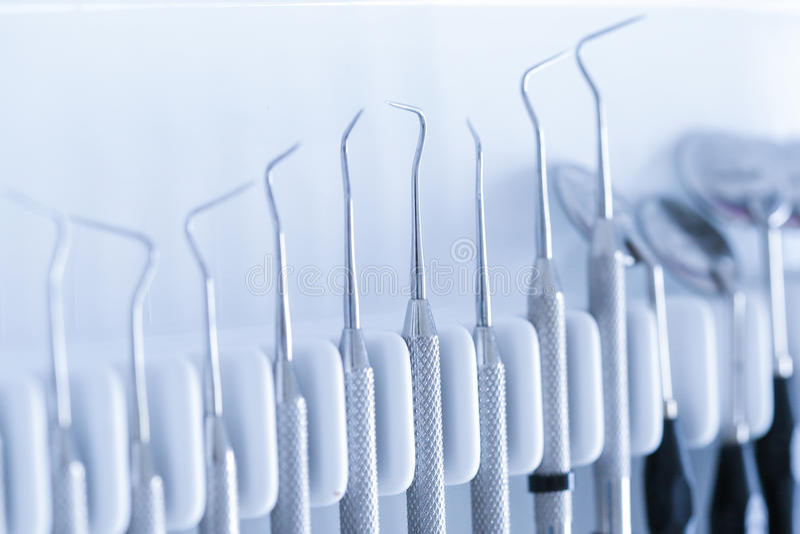 Exploratory dental tools. Dental explorer, burnisher, periodontal probe, dental mirror royalty free stock photography
