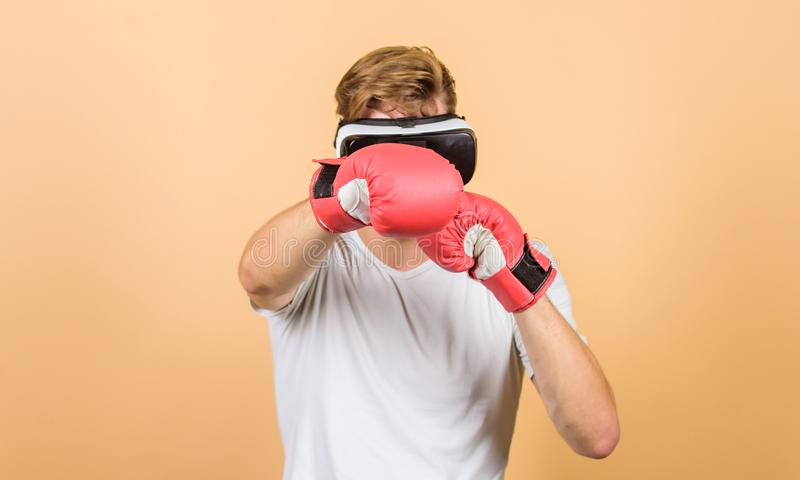Explore cyber space. Cyber sportsman boxing gloves. Augmented 3D world. Man boxer virtual reality headset simulation stock images