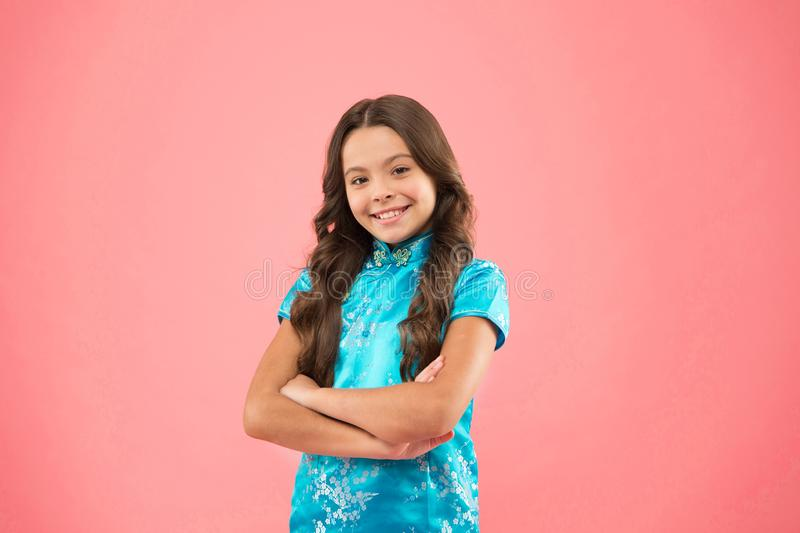 Explore different cultures. Cultural diversity. Little smiling girl wear eastern style clothes. Diversity concept stock photo