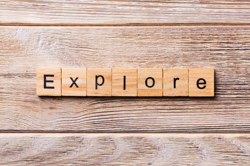 Explore word written on wood block. Explore text on wooden table for your desing, concept stock photography