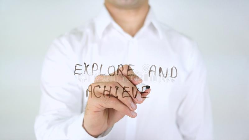 Explore y alcance, sirva la escritura sobre el vidrio imagen de archivo libre de regalías