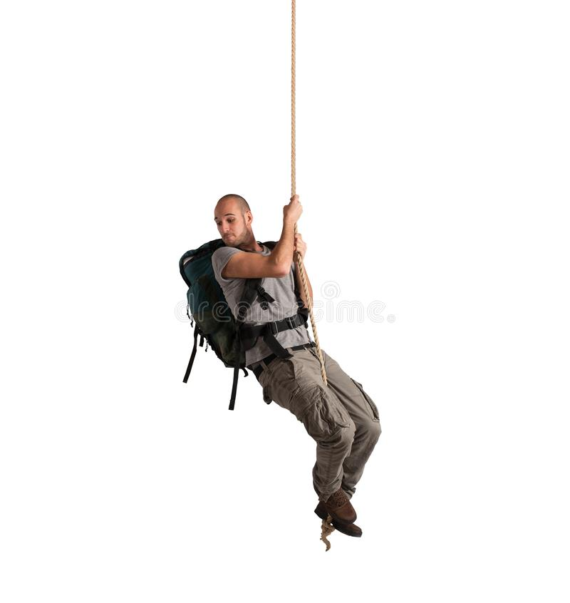 Explorer hanging from a rope stock images