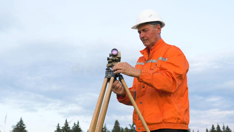 Explorer in orange types on smartphone by geodetic device stock image