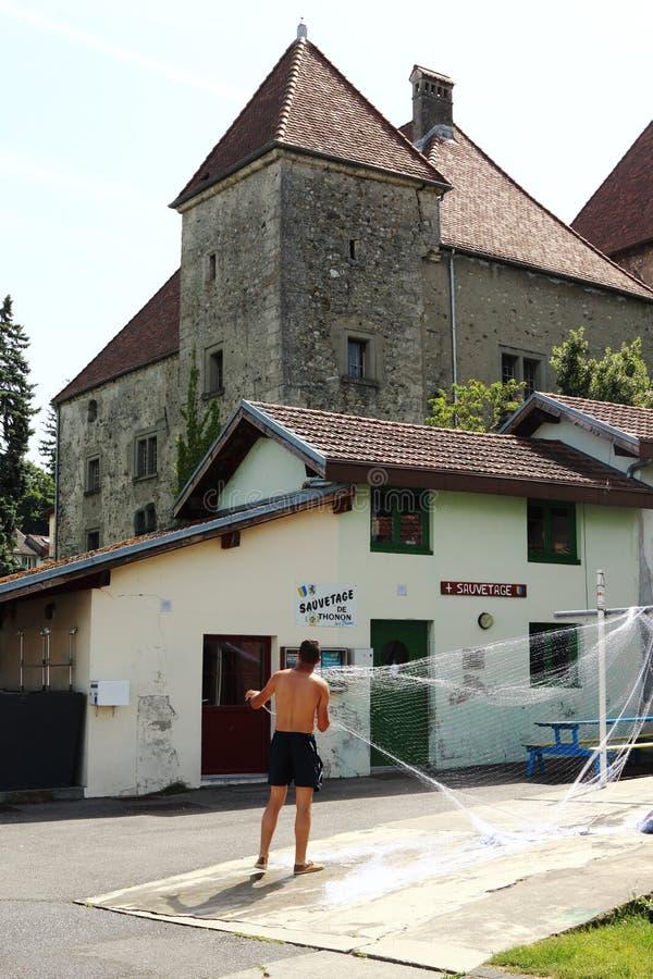 Exploring fishing nets in Port de Rives, Thonon-les-Bains, France stock image