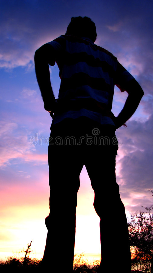 Exploring Heights. An explorer watches the sunset in the Indian wild stock photos