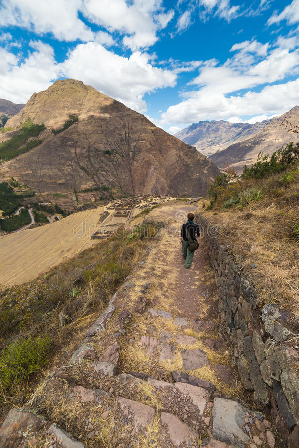 Exploring Inca Trails and ruins of Pisac, Peru. Tourist exploring the Inca Trails leading to the ruins of Pisac, Sacred Valley, major travel destination in Cusco stock images