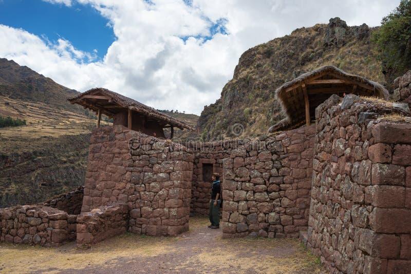 Exploring Inca Trails and ruins of Pisac, Peru. Tourist exploring the Inca Trails leading to the ruins of Pisac, Sacred Valley, major travel destination in Cusco stock image