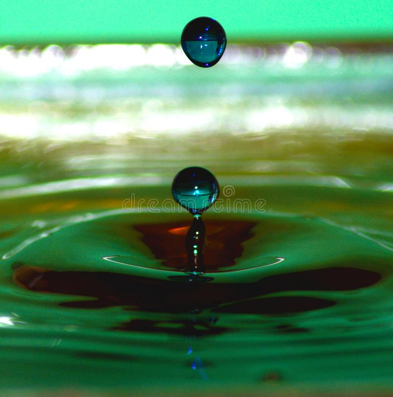 Defy Gravity. Exploring water dripping drops few different colors mixed royalty free stock photos
