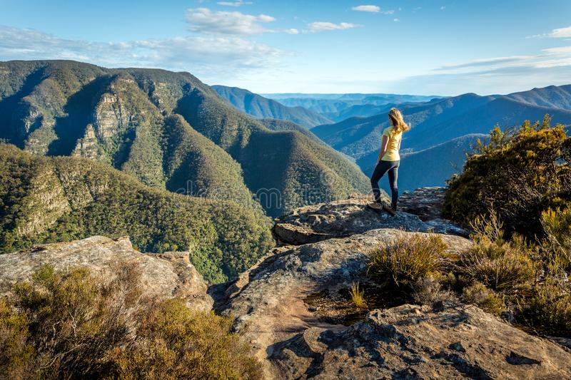 Exploring wild mountain ranges of NSW Australia. A female hiker exploring some of the wildest mountain rainges of the Great Dividing Range of NSW Australia stock photography