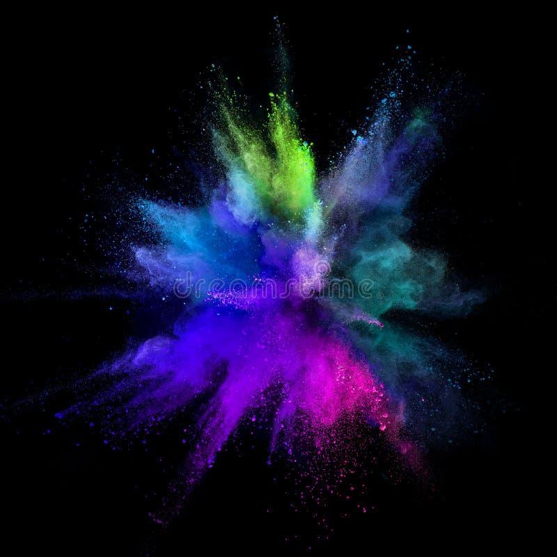 Explosão colorida do pó no fundo preto fotografia de stock royalty free
