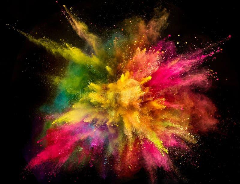 Explosão colorida do pó no fundo preto fotos de stock royalty free