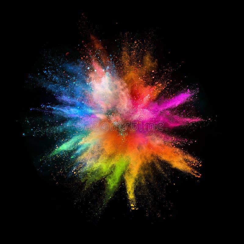 Explosão colorida do pó no fundo preto imagem de stock