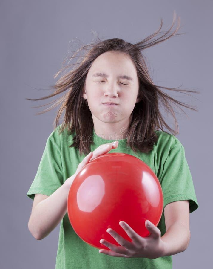 Explosão da menina e do balão foto de stock