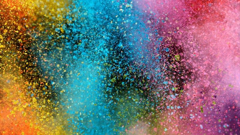 Explosão de pó colorido isolado sobre fundo negro foto de stock