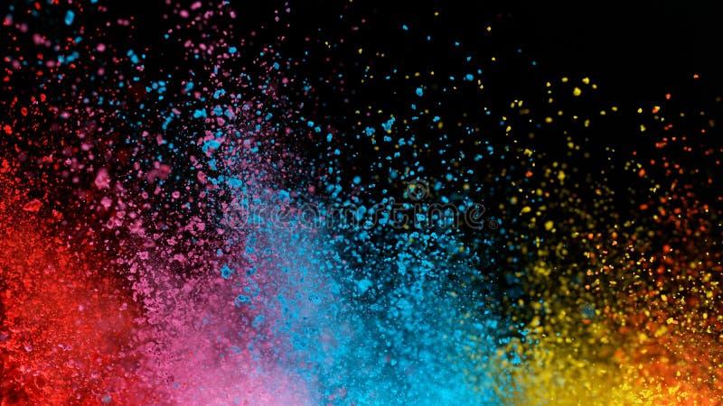 Explosão de pó colorido isolado sobre fundo negro imagem de stock royalty free