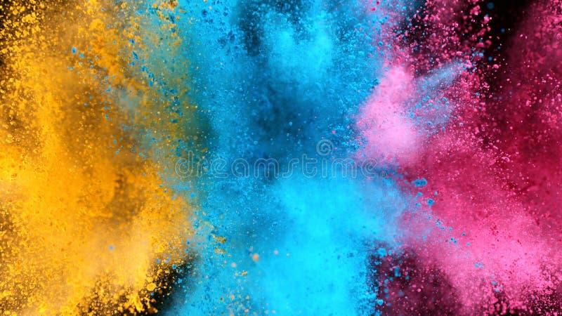 Explosão de pó colorido isolado sobre fundo negro fotografia de stock royalty free