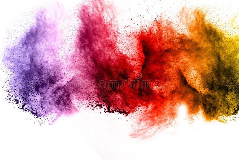 Explosão do pó da cor no fundo branco fotografia de stock royalty free