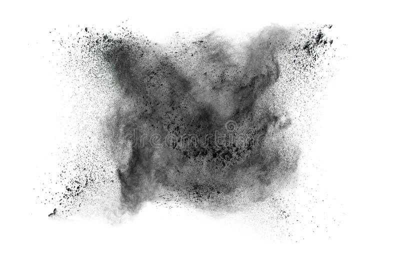 Explosão do pó preto contra o fundo branco imagem de stock royalty free
